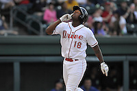 First baseman Josh Ockimey (18) of the Greenville Drive crosses the plate after a home run in a game against the Columbia Fireflies on Thursday, April 21, 2016, at Fluor Field at the West End in Greenville, South Carolina. Columbia won, 13-9. (Tom Priddy/Four Seam Images)