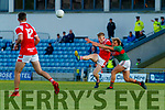 Evan Cronin, East Kerry in action against Fiachra Clifford, Mid Kerry during the Kerry County Senior Football Championship Final match between East Kerry and Mid Kerry at Austin Stack Park in Tralee on Saturday night.