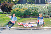 Attendees wear American flag and pro-Trump clothing as the alt-right organization Super Happy Fun America demonstrates against facemasks, vaccines, and pandemic closures, and in support of the reelection of President Donald J. Trump near the residence of Massachusetts governor Charlie Baker in Swampscott, Massachusetts, on Sat., Sept. 26, 2020. Super Happy Fun America is most well known for organizing the Straight Pride Parade in Boston on August 31, 2019.