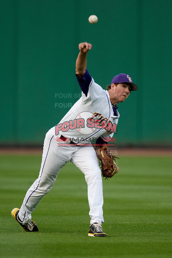 LSU Tigers starting pitcher Kevin Gausman #12 warms up before his start against the Mississippi State Bulldogs during the NCAA baseball game on March 16, 2012 at Alex Box Stadium in Baton Rouge, Louisiana. LSU defeated Mississippi State 3-2 in 10 innings. (Andrew Woolley / Four Seam Images).