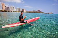Local man enjoying a surf session on a sunny day in Waikiki