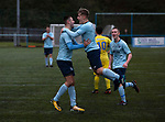 Home team players celebrating their team's decisive second goal during the second-half as Cambrian and Clydach Vale (in blue) take on Cwmbran Celtic at King George's New Field in a Welsh League Division One match, the top division of the Welsh Football League and the second level of the Welsh football league system. The club, formed in 1965 reached the final of the 2018-19 League Cup final and can count on ex-England manager Terry Venables as a former club chairman. Cambrian and Clydach Vale won this match 2-0, watch by a crowd of around 100 spectators.