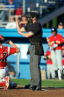 Home plate umpire Clayton Hamm makes a call during a game between the State College Spikes and Batavia Muckdogs at Dwyer Stadium on August 7, 2012 in Batavia, New York.  State College defeated Batavia 4-2.  (Mike Janes/Four Seam Images)