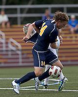 Quinnipiac University defender Matthew Rothbart (14) successful defense. Boston College defeated Quinnipiac, 5-0, at Newton Soccer Field, September 1, 2011.