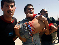 """Palestinians carrying an injuerd child during  Hamas demonstration in the Karni crossing east of Gaza City that injured 10 people and killing people by the Israeli army on May 22, 2008""""photo by Fady Adwan"""""""