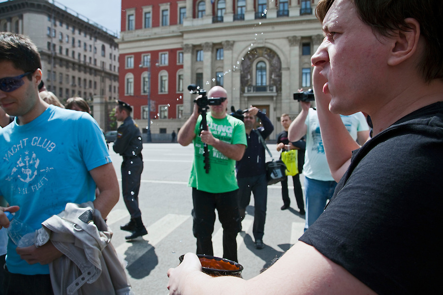Moscow, Russia, 27/05/2012..A Russian nationalist throws holy water over a gay rights demonstrator at an attempted gay pride parade in central Moscow. Several dozen people were arrested during clashes as Russian nationalists attacked gay rights activists during their seventh attempt to hold a gay pride parade in the Russian capital.