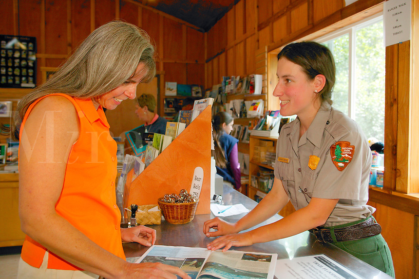 Janine Niebrugge being helped Park employee Bonnie Moore at the Exit Glacier Nature Center, Kenai Fjords National Park, Seward, Alaska.