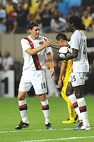 Teammate Gareth Barry congratulates forward Emmanuel Adebayor after his penalty kick gave Manchester City a 1-0 first-half lead. The 2010 Atlanta International Soccer Challenge was held, Wednesday, July 28, at the Georgia Dome, featuring a match between Club America and Manchester City. After regulation time ended 1-1, Manchester City was awarded the victory, winning 4-1, in penalty kicks.