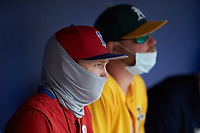 Philadelphia Phillies scout Kellan McKeon (left) watches from the dugout during game five of the South Atlantic Border Battle at Truist Point on September 27, 2020 in High Pont, NC. (Brian Westerholt/Four Seam Images)
