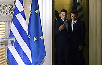 Pictured: French President Emmanuel Macron (R) and Greek Prime Minister Alexis Tsipras prepare to take to their podiums at Maximos Mansion in Athens, Greece. Thurday 07 September 2017<br /> Re: French President Emmanuel Macron state visit to Athens, Greece.