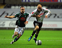 ATTENTION SPORTS PICTURE DESK<br /> Pictured: David Cotterill of Swansea (R) against Darcy Blake of Plymouth Argyle<br /> Re: Coca Cola Championship, Swansea City Football Club v Plymouth Argyle at the Liberty Stadium, Swansea, south Wales. Tuesday 08 December 2009