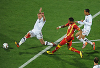 Kevin Prince Boateng of Ghana scores past Jay DeMerit and Ricardo Clark of USA. USA vs Ghana in the 2010 FIFA World Cup at Royal Bafokeng Stadium in Rustenburg, South Africa on June 26, 2010.