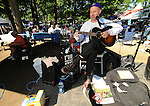 28 August 10: Ernie Munick, wandering video journalist and apparently wandering minstrel, plays the back yard at the Travers Stakes at Saratoga Race Course in  Saratoga Springs, New York.