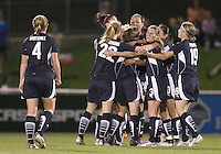 Lori Lindsey #6 of the Washington Freedom is surrounded by teammates after scoring against the Boston Breakers during a WPS match at the Maryland Soccerplex, in Boyd's, Maryland, on April 18 2009. Breakers won the match 3-1.
