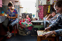 Vladimir Petrenko (right), who has liver problems, sits at home with with his invalid wife, Lubov (reclining on bed), their daughter-in-law, Elena, and grandson, Valery, who suffers from hemophilia. They rely on the Matvei Mudrov medical train for their medical needs. <br /> <br /> The Matvei Mudrov train is a medical train operated by Russian Railways along the course of the Baikal Amur Magistral (Baikal-Amur Mainline, or BAM) railway line. Named after a famous 19th century Russian physician, the train employs around 15 doctors who make about 10 trips a year, each lasting two weeks. Along the way they deliver essential medical services to people living in remote villages along the 4,324 km long BAM railway. Though not equipped to carry out surgical procedures the train has heart monitors, ultrasound and x-ray machines to deliver diagnosis.