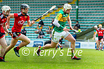 Shane Nolan, Kerry in action against Gerard Hughes, and Liam Savage, Down during the National hurling league between Kerry v Down at Austin Stack Park, Tralee on Sunday.