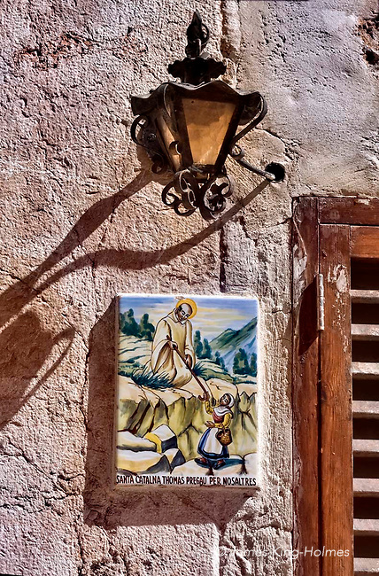 A tile plaque near the street door of a house in Valldemossa, Mallorca, in honour of the local saint, Santa Catalina Thomas who was born in the village in 1533 and canonised in 1930. The plaques, which can be seen on many houses in the old town, depict incidents in the saint's life and work.