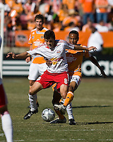 New York Red Bulls midfielder Sinisa Ubiparipovic (8) and Houston Dynamo mdifielder Ricardo Clark (13).  New York Red Bulls defeated Houston Dynamo 3-0 for an aggregate  score of 4-1 over Houston Dynamo   at Robertson Stadium in Houston, TX on November 9, 2008 in the second leg of the Western Conference semifinals.  Photo by Wendy Larsen/isiphotos.com