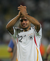 German midfielder (22) David Odonkor shows his emotions as he waves to the crowd.  Italy defeated Germany, 2-0, in overtime in their FIFA World Cup semifinal match at FIFA World Cup Stadium in Dortmund, Germany, July 4, 2006.