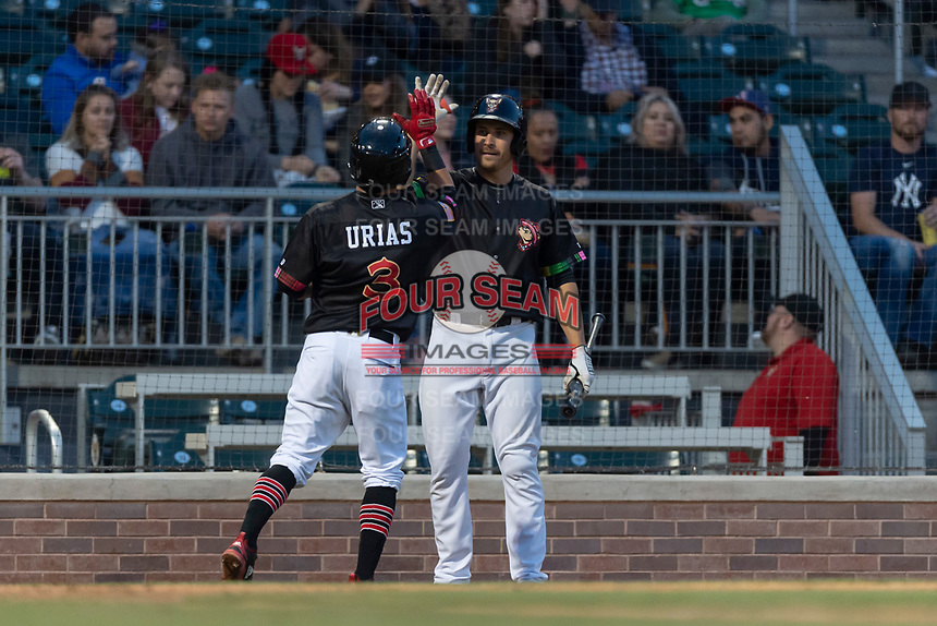 El Paso Chihuahuas third baseman Seth Mejias-Brean (17) congratulates Luis Urias (3) after his home run during a Pacific Coast League game against the Albuquerque Isotopes at Southwest University Park on May 10, 2019 in El Paso, Texas. Albuquerque defeated El Paso 2-1. (Zachary Lucy/Four Seam Images)