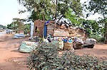 Landfill, Kampala, Uganda..Middle-men collection sites on the road outside the municipal dump in Kampala, Uganda.   Truck collect the materials and transport it to Kenya for recycling.