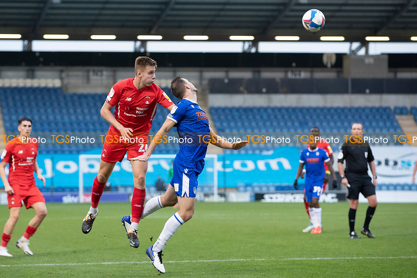 Hector Kyprianou, Leyton Orient out jumps Tommy Smith, Colchester United with the aid of a push during Colchester United vs Leyton Orient, Sky Bet EFL League 2 Football at the JobServe Community Stadium on 14th November 2020