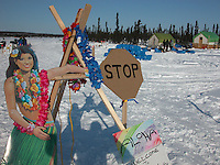 Jon Little.Race volunteers had some fun welcoming in mushers to the remote Cripple checkpoint with a cardboard hula cutout and an inflatable palm tree. March 9, 2006