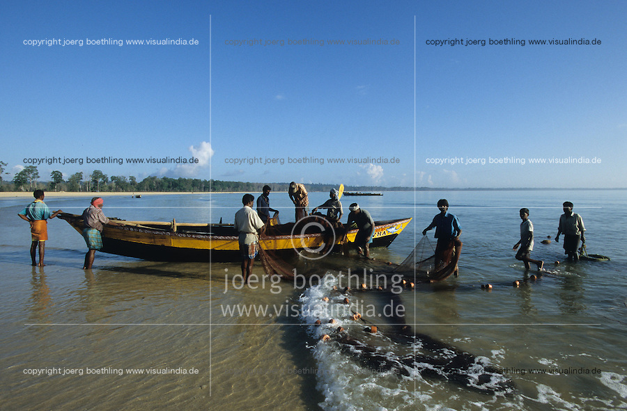 INDIA, Andaman and Nicobar Islands, fishermen at beach with new boat at work after Tsunami in Hut bay on Little Andaman island / INDIEN, Andamanen und Nikobaren Inseln, Fischer am Strand mit neuen Booten und Netzen bei der Arbeit nach Tsunami auf Insel Little Andaman im Ort Hut Bay