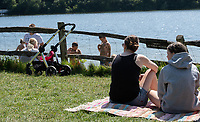 Ardingly, ENGLAND. 25.05.2020<br /> .<br /> People ignoring the sign of Private No Public Access gather in groups to enjoy the sun during the bank holiday Monday Covid-19 lockdown with government guidelines to social distance  at Ardingly Reservoir, Ardingly, West Sussex, England at  on 25 May 2020. Photo by Alan Stanford.