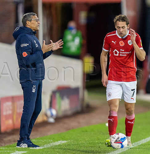 21st November 2020, Oakwell Stadium, Barnsley, Yorkshire, England; English Football League Championship Football, Barnsley FC versus Nottingham Forest; Chris Hughton of Nottingham Forrest shouting from side lines with Callum Brittain of Barnsley covering ear