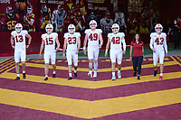 LOS ANGELES, CA - SEPTEMBER 11: The Stanford Cardinal kicking specialist head out to the field before a game between University of Southern California and Stanford Football at Los Angeles Memorial Coliseum on September 11, 2021 in Los Angeles, California.