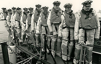 BNPS.co.uk (01202 558833)<br /> Pic: RNLI<br /> <br /> Gallantry medallists in 1988.<br /> <br /> Splash in the Attic...<br /> <br /> A 'lost' cache of 13,000 photographs charting the history of the RNLI has been found in the attic of the charity's headquarters.<br /> <br /> Many of the black and white photos date back to the 1920s and '30s long before the terms 'health and safety' and 'risk assessment' were thought of.<br /> <br /> One image depicts a brave lifeboatman dressed in a suit and cloth cap just as the lifeboat he is on launches down a ramp into a choppy sea.<br /> <br /> Another shows the crew of another open lifeboat getting swamped by waves with only their souwesters and lifejackets to protect them.<br /> <br /> The photos have been unearthed in storage space at the RNLI HQ in Poole, Dorset, and they are now being digitised.