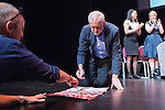 © Joel Goodman - 07973 332324 . 23/07/2016 . Salford , UK . Jeremy Corbyn signs campaign posters for supporters after launching his campaign to be re-elected Labour Party leader , at the Lowry Theatre at Salford Quays . Photo credit : Joel Goodman