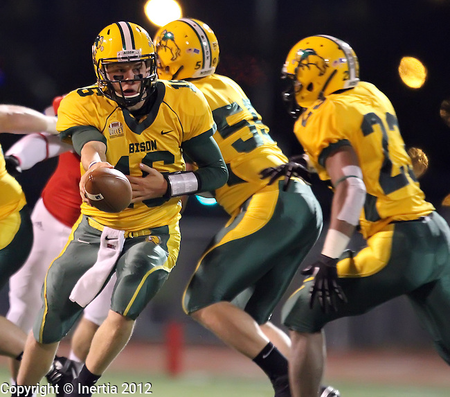 SIOUX FALLS, SD - OCTOBER 20:  Brock Jensen #16 hands the football off to Sam Ojuri #22 from North Dakota State University in the second quarter of their game against South Dakota State University, Saturday night at Howard Wood Field.  (Photo by Dave Eggen/Inertia)