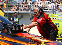 Mar 15, 2015; Gainesville, FL, USA; Crew chief Tommy DeLago guides NHRA funny car driver Alexis DeJoria to stage during the Gatornationals at Auto Plus Raceway at Gainesville. Mandatory Credit: Mark J. Rebilas-