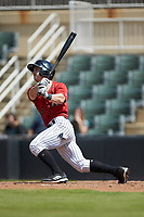 Ian Dawkins (6) of the Kannapolis Intimidators follows through on his swing against the Greensboro Grasshoppers at Kannapolis Intimidators Stadium on August 5, 2018 in Kannapolis, North Carolina. The Grasshoppers defeated the Intimidators 2-1 in game one of a double-header.  (Brian Westerholt/Four Seam Images)