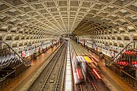 A subway train creates a blur as it leaves the Farragut West station of the Washington DC metro.