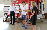 Steuart Walton (center), Runway Group Co-Founder, stands with Bentonville fire chief Brent Boydston (left) and Bentonville mayor Stephanie Orman as they make the formal announcement Monday, July 26, 2021, of the purchase of a new aircraft rescue firefighting vehicle at Station No. 6 in Bentonville. The event recognized an $800,000 grant to the Fire Department to purchase an aircraft rescue firefighting vehicle for the municipal airport. The City Council recently approved a budget adjustment of $800,000 in revenue via The Runway Fund at Fidelity Charitable grant at the recommendation of Steuart Walton, and allocated $865,000 in expenses to purchase the vehicle. Check out nwaonline.com/210727Daily/ and nwadg.com/photos for a photo gallery.(NWA Democrat-Gazette/David Gottschalk)