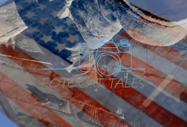 Reflections of the Nevada Veterans Memorial on the case of a historic 36-star America Flag on display at the annual the Flag Day ceremony on the Capitol grounds in Carson City, Nev., on Friday, June 14, 2019. <br />Photo by Cathleen Allison/Nevada Momentum