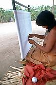 Ipixuna village, Amazon, Brazil. Young Arawte woman weaving cotton on a traditional loom.