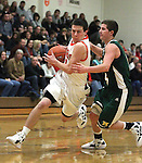 Douglas' Connor Hughes drives past Manogue defender Gray Reid during a boys basketball game between Bishop Manogue and Douglas High in Minden, Nev., on Thursday, Dec. 22, 2011..Photo by Cathleen Allison