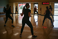 Kelly Burton dances, Monday, January 11, 2021 at the Bentonville Community Center in Bentonville. Attendees participated in the twice-weekly, high-energy Dance Fit class. Check out nwaonline.com/210112Daily/ for today's photo gallery. <br /> (NWA Democrat-Gazette/Charlie Kaijo)