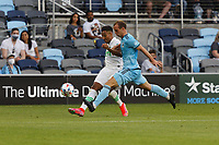 SAINT PAUL, MN - MAY 1: Chase Gasper #77 of Minnesota United FC battles for the ball during a game between Austin FC and Minnesota United FC at Allianz Field on May 1, 2021 in Saint Paul, Minnesota.