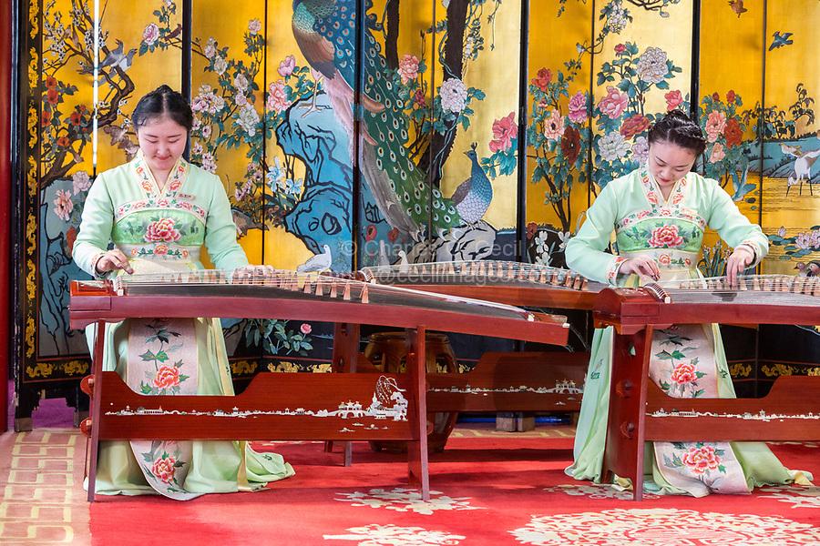 Yangzhou, Jiangsu, China.  Young Women Playing the Guzheng, Slender West Lake Park.