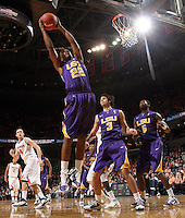 Jan. 2, 2011; Charlottesville, VA, USA; LSU Tigers guard Ralston Turner (22) grabs a rebound during the game against the Virginia Cavaliers at the John Paul Jones Arena. Virginia won 64-50. Mandatory Credit: Andrew Shurtleff-