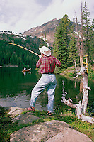 Cathedral Provincial Park near Keremeos, BC, British Columbia, Canada - Woman fishing from Shore at Quiniscoe Lake (Model Released Woman in foreground)