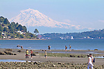 Seattle, Mount Rainier, Discovery Park, people exploring low tide beach, Magnolia Bluff, Puget Sound, Washington State, Pacific Northwest, USA,