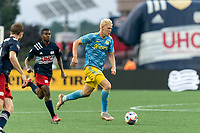 FOXBOROUGH, MA - AUGUST 8: Jakob Glesnes #5 of Philadelphia Union brings the ball forward as Maciel #13 of New England Revolution closes during a game between Philadelphia Union and New England Revolution at Gillette Stadium on August 8, 2021 in Foxborough, Massachusetts.