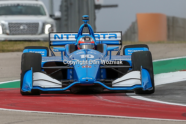 Indy cars and Super Trucks in action during the practice round at the Circuit of the Americas racetrack in Austin,Texas.
