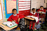 K-8 Parochial School Bronx New York Grade 4 row of listening students horizontal